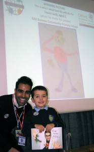 Dr Ranj with poster competition winner Owen Lock at RAF Benson primary school